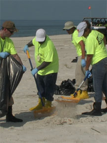 BEACH CLEANING, Oil tar ball removal in Gulf Shores Alabama, Christy